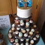 Bodega Bay Beach themed wedding cake with cupcakes